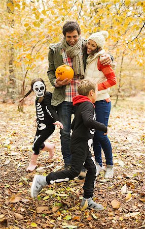 Couple with children in skeleton costumes in park Stock Photo - Premium Royalty-Free, Code: 6113-06721240