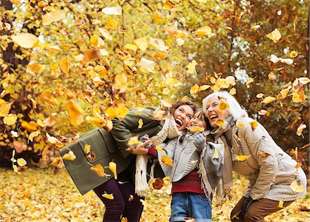 Three generations of women playing in autumn leaves Stock Photo - Premium Royalty-Free, Code: 6113-06721241
