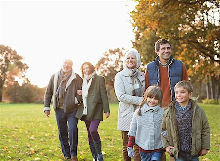Family walking together in park Stock Photo - Premium Royalty-Free, Code: 6113-06721242