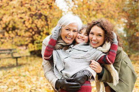 Three generations of women smiling in park Stock Photo - Premium Royalty-Free, Code: 6113-06721247