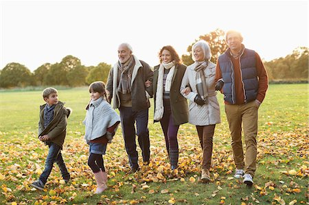 Family walking together in park Stock Photo - Premium Royalty-Free, Code: 6113-06721252