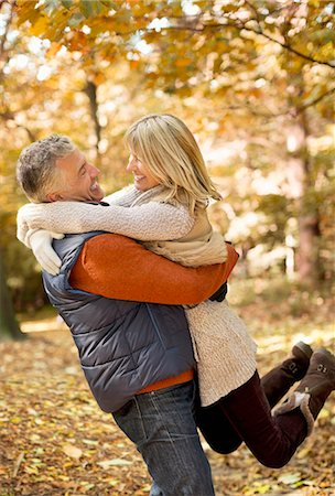 Older couple hugging in park Stock Photo - Premium Royalty-Free, Code: 6113-06721266
