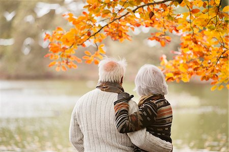 Older couple standing in park Stock Photo - Premium Royalty-Free, Code: 6113-06721222