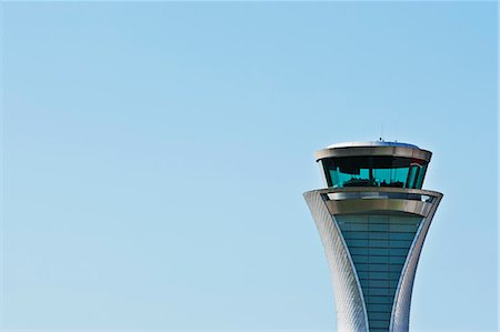 Air traffic control tower and blue sky Stock Photo - Premium Royalty-Free, Code: 6113-06721375