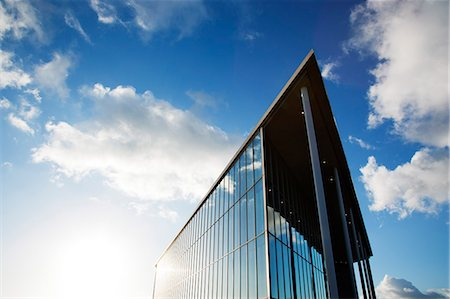 Blue sky reflected in modern building Stock Photo - Premium Royalty-Free, Code: 6113-06721389