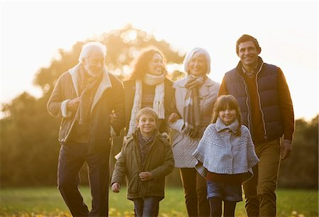 Family walking together in park Stock Photo - Premium Royalty-Free, Code: 6113-06721312