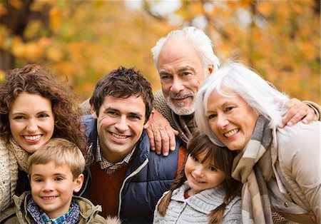 Family smiling together in park Stock Photo - Premium Royalty-Free, Code: 6113-06721319