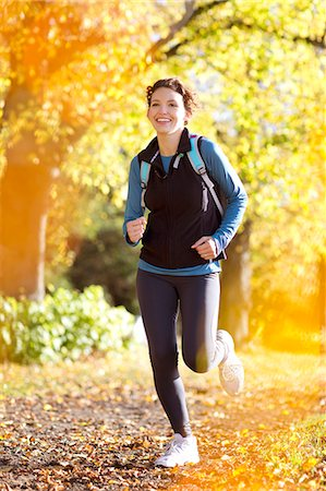 Woman running in park Stock Photo - Premium Royalty-Free, Code: 6113-06721330