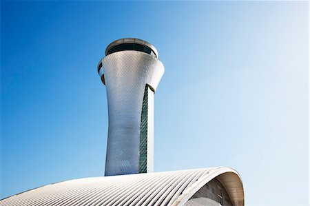 Air traffic control tower and blue sky Stock Photo - Premium Royalty-Free, Code: 6113-06721402