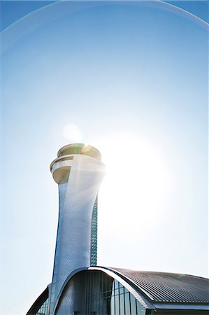 Air traffic control tower and blue sky Stock Photo - Premium Royalty-Free, Code: 6113-06721416