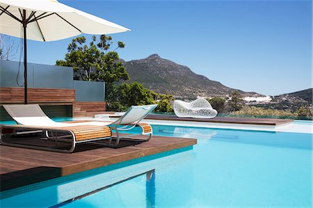 pool - Luxury swimming pool with mountain view Stock Photo - Premium Royalty-Free, Code: 6113-06898811
