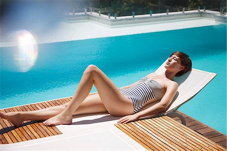 sexi women full body - Woman sunbathing on lounge chair at luxury poolside Stock Photo - Premium Royalty-Free, Code: 6113-06898827
