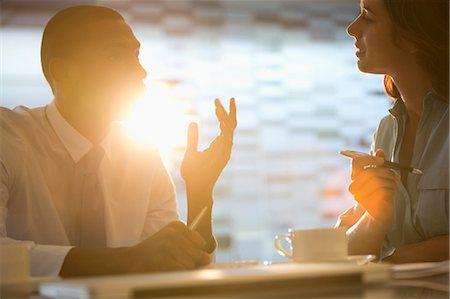 Businessman and businesswoman talking Stock Photo - Premium Royalty-Free, Code: 6113-06898988