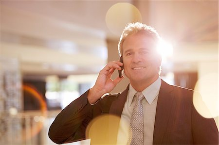 Portrait of confident businessman talking on cell phone Stock Photo - Premium Royalty-Free, Code: 6113-06898989