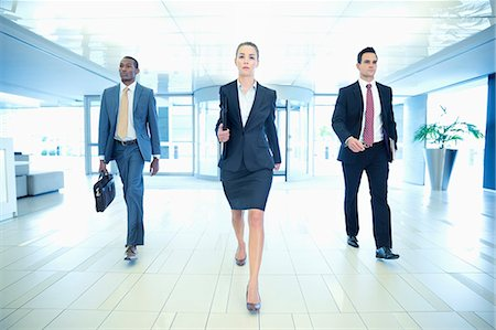 Determined business people walking in lobby Stock Photo - Premium Royalty-Free, Code: 6113-06898990