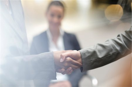 Close up of business people handshaking Stock Photo - Premium Royalty-Free, Code: 6113-06899051