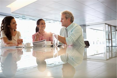 Business people talking in lobby Stock Photo - Premium Royalty-Free, Code: 6113-06899069