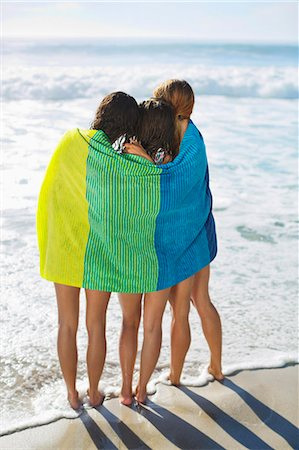 friendship - Friends wrapped in towel on beach Stock Photo - Premium Royalty-Free, Code: 6113-06899188