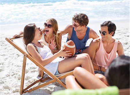 dark glasses - Happy friends with football hanging out at beach Stock Photo - Premium Royalty-Free, Code: 6113-06899240
