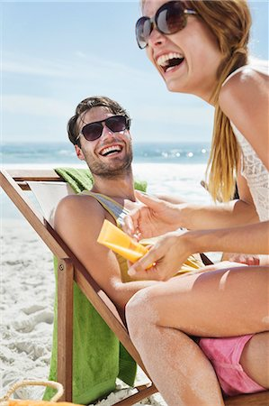 sunglasses - Happy couple with sunscreen at beach Stock Photo - Premium Royalty-Free, Code: 6113-06899270