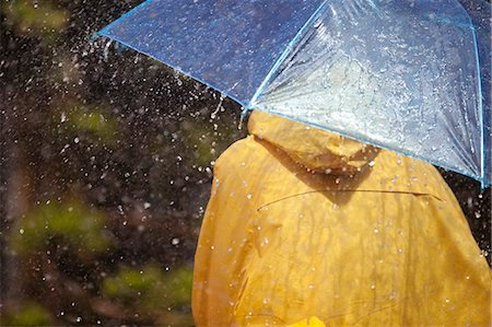 people with umbrellas in the rain - Woman under umbrella in rain Stock Photo - Premium Royalty-Free, Code: 6113-06899548