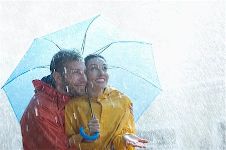 people with umbrellas in the rain - Happy couple under umbrella in rain Stock Photo - Premium Royalty-Free, Code: 6113-06899557