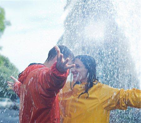 Happy couple dancing in rain Stock Photo - Premium Royalty-Free, Code: 6113-06899523