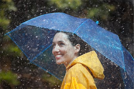 people with umbrellas in the rain - Happy woman with umbrella in rain Stock Photo - Premium Royalty-Free, Code: 6113-06899537