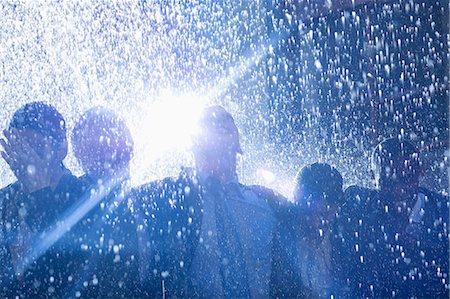 Business people in rain Stock Photo - Premium Royalty-Free, Code: 6113-06899627