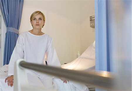 Patient sitting on hospital bed Stock Photo - Premium Royalty-Free, Code: 6113-06908191