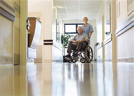 Nurse wheeling older patient in hospital Stock Photo - Premium Royalty-Free, Code: 6113-06908192