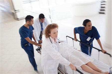 patient walking hospital halls - Hospital staff rushing patient to operating room Stock Photo - Premium Royalty-Free, Code: 6113-06908248