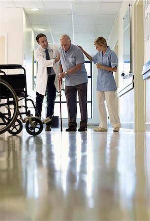 patient walking hospital halls - Doctor and nurse helping older patient walk in hospital Stock Photo - Premium Royalty-Free, Code: 6113-06908267