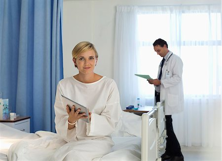 people hospital - Patient using tablet computer in hospital room Stock Photo - Premium Royalty-Free, Code: 6113-06908285