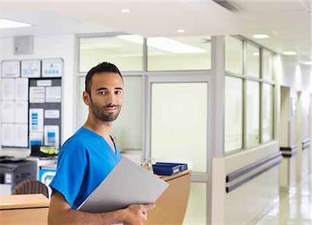 registered nurse - Nurse smiling in hospital hallway Stock Photo - Premium Royalty-Free, Code: 6113-06908233