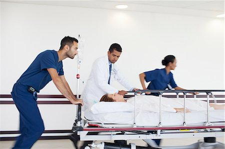 patient walking hospital halls - Hospital staff rushing patient to operating room Stock Photo - Premium Royalty-Free, Code: 6113-06908326