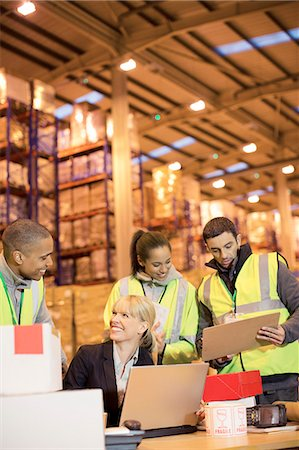 entry field - Businesswoman and workers talking in warehouse Stock Photo - Premium Royalty-Free, Code: 6113-06908451