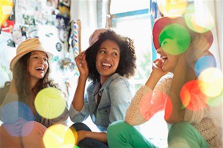 Women wearing hats in bedroom Stock Photo - Premium Royalty-Free, Code: 6113-06908487