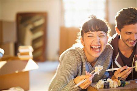 eating - Couple eating sushi together Stock Photo - Premium Royalty-Free, Code: 6113-06908484
