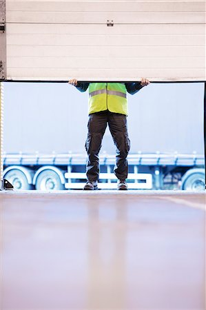safety - Worker lifting door in warehouse Stock Photo - Premium Royalty-Free, Code: 6113-06908412