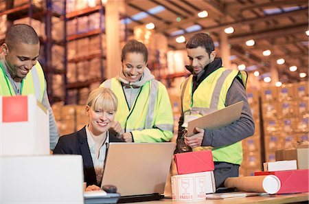 entry field - Businesswoman and workers using laptop in warehouse Stock Photo - Premium Royalty-Free, Code: 6113-06908436