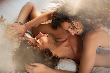 Couple relaxing together in bed Stock Photo - Premium Royalty-Free, Code: 6113-06908543