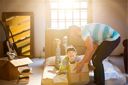 Couple unpacking boxes in attic Stock Photo - Premium Royalty-Free, Code: 6113-06908554