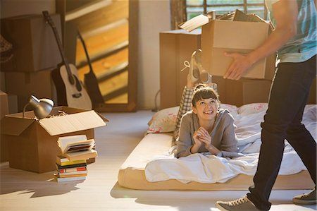 flat - Couple unpacking boxes in attic Stock Photo - Premium Royalty-Free, Code: 6113-06908558