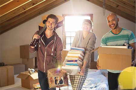 Friends unpacking boxes in attic Stock Photo - Premium Royalty-Free, Code: 6113-06908562
