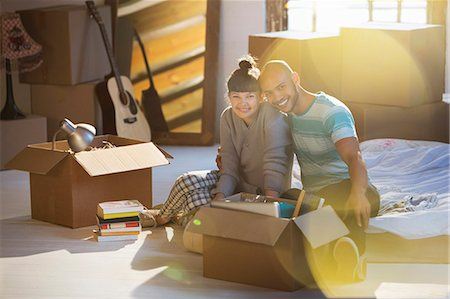 Couple unpacking boxes in attic Stock Photo - Premium Royalty-Free, Code: 6113-06908564