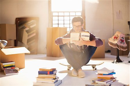 Man reading in new home Stock Photo - Premium Royalty-Free, Code: 6113-06908583