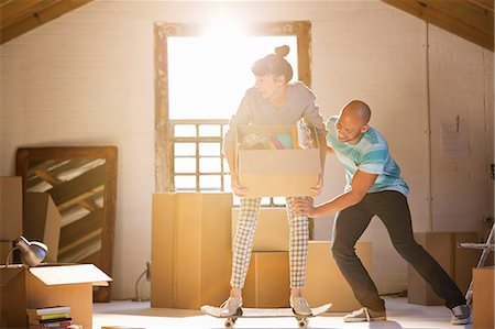 Couple unpacking boxes in new home Stock Photo - Premium Royalty-Free, Code: 6113-06908581