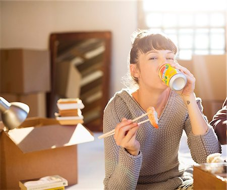 people eating at lunch - Woman drinking soda and eating sushi in new home Stock Photo - Premium Royalty-Free, Code: 6113-06908505