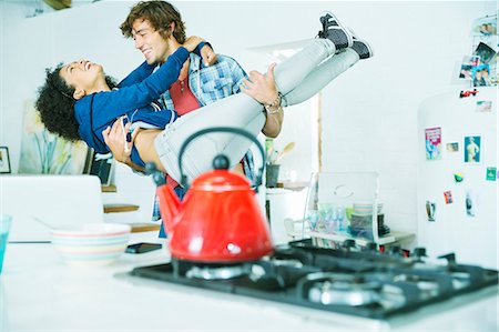 Couple playing together in kitchen Stock Photo - Premium Royalty-Free, Code: 6113-06908515